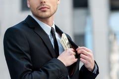 Stoppa i fickan företagspengar. Royaltyfria Foton