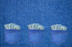 Stoppa i fickan med dollar på bakgrunden av grov bomullstvill Fotografering för Bildbyråer
