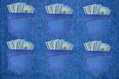 Stoppa i fickan med dollar på bakgrunden av grov bomullstvill Arkivbild