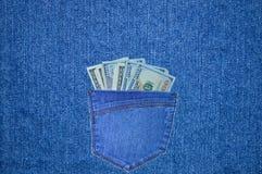 Stoppa i fickan med dollar på bakgrunden av grov bomullstvill Royaltyfria Bilder