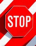 Stoppa tecknet på en vägg Royaltyfri Fotografi