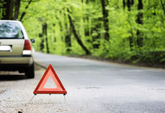 Stopped  car. Stopped car in  the woods  with  a warning triangle Stock Images