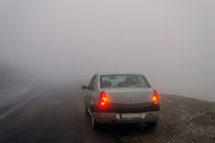 Stopped car in the fog Stock Photo