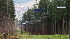 Stopped ski lifts in the autumn in the mountains stock video footage