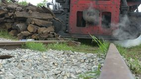 Stopped Steam Train. Rail ground view of a parked steam vintage locomotive stock video footage