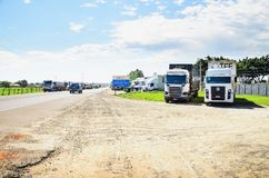 Stopped trucks on the highways for protest the diesel price incr. Campo Grande, Brazil - May 24, 2018: Stopped trucks on the highways for protest the diesel Stock Photo
