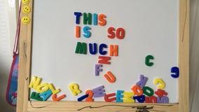Stoppen Sie Bewegungs-magnetische Buchstaben stock video footage