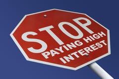 Stoppen Sie hohe Zinsen stockbilder