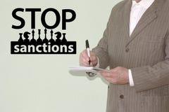 Stoppen Sie Sanktionskonzept politisch lizenzfreies stockbild