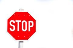 Stoppen Sie Zeichen auf Weiß Lizenzfreie Stockfotos