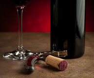 Stopper on corkscrew near bottle and wine glass Stock Photos