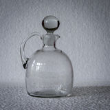 A stoppered clear glass pitcher Stock Image