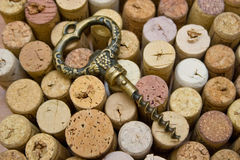 Stoppers and old corkscrew. A closeup, detailed view of a corkscrew used to pull corks from wine bottles Royalty Free Stock Photo