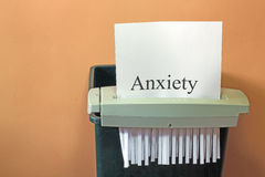 Stopping anxiety. A shredder about to shred anxiety and stop the problem royalty free stock photography
