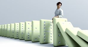 Dominoes Chain Reaction. Stopping a chain reaction of dominoes Royalty Free Stock Images