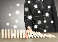 Stopping domino concept. Business solution Stock Image