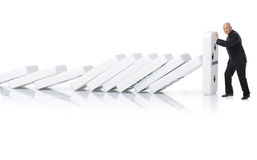 Stopping a domino effect Stock Photography