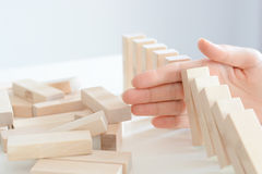 Stopping the domino effect concept with a business solution Stock Images