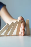 Stopping the domino effect concept with a business solution. And intervention Stock Images
