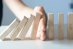 Stopping the domino effect concept with a business solution Royalty Free Stock Photos