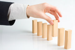Stopping the domino effect Stock Photography