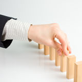 Stopping the domino effect Royalty Free Stock Photos