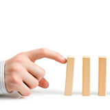 Stopping the domino effect Royalty Free Stock Photography