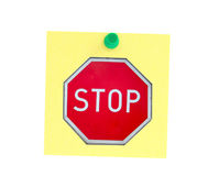 Stopping post-it. Red stop sign on a yellow post-it note with a green pin isolated on white Stock Photography