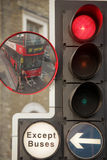 Stopping at red light. Cyclist and a bus stopping on the traffic lights, central London, UK Stock Photography