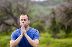 Stopping to pray in nature. Stock Image