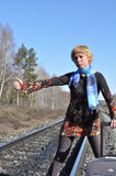 Stopping train. A joke, funny picture, a young woman with a big bag wants to stop the train, way hitchhiking Stock Photography
