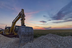 A stopping yellow excavator Royalty Free Stock Photography