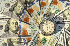 Stoppur och dollar (tid är pengar, huvudstad, besparingar, vinst - Royaltyfri Bild