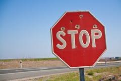 Stopsign med kulhålet Fotografering för Bildbyråer