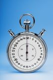 Stopwatch. Mechanic chromed stopwatch on blue background. Front view royalty free stock images