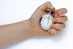 Stopwatch. In hand on white Stock Image