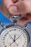 Stopwatch. Hand with stopwatch Royalty Free Stock Photos