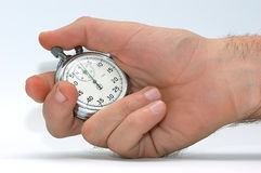 Stopwatch. White in the hand Stock Photo