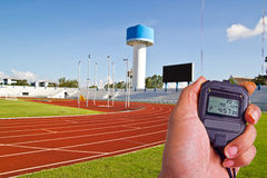 Stopwatch in athletics field Royalty Free Stock Photo