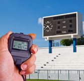 Stopwatch in athletics field Royalty Free Stock Images