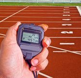 Stopwatch in athletics field Stock Images