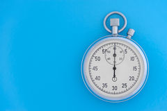 Stopwatch on blue background Royalty Free Stock Photos