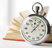 Stopwatch and book Royalty Free Stock Images