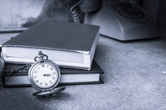 Stopwatch and book on wooden Royalty Free Stock Photos