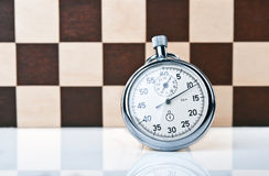 Stopwatch and chessboard Stock Image