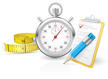 Stopwatch with clipboard and tape measure Stock Photo