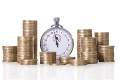 Stopwatch And Coin Stacks Stock Photo