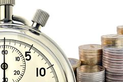 Stopwatch and coins. Fragment of mechanical stop-watch and coins against white background Stock Image