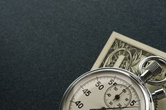 Stopwatch and dollar Royalty Free Stock Photography