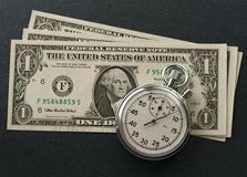 Stopwatch and dollars Royalty Free Stock Images